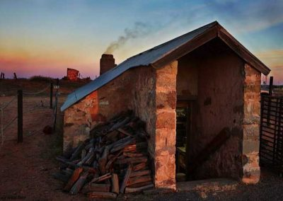 Bakery at dawn, oven stoked up and a pile of wood ready for the day ahead