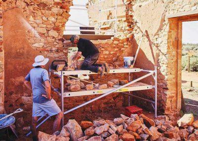 Stonemasons rebuilding wall Exchange Hotel