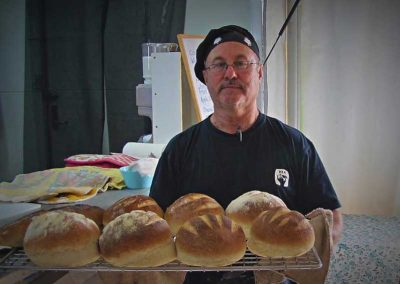 Jeremy with a tray of artisan bread.