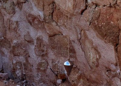 The plumb bob on the other side of the wall.