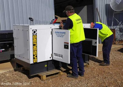 New (larger) Diesel generator being prepared for placement and installation.