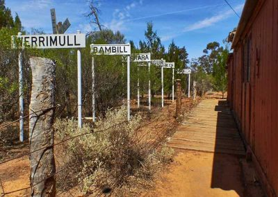 Various (now disused) railway siding signs now stand alongside one of the freight cars at the Meringur museum.